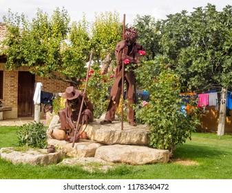 Boadilla del Camino, Castile and Leon, Spain - September 15, 2014: Rusty metal statue of two pilgrims in the courtyard of the En El Camino hostel (albergue)