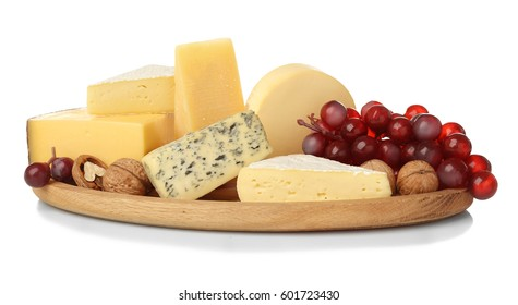 Board with assortment of delicious cheese, grape and nuts on white background