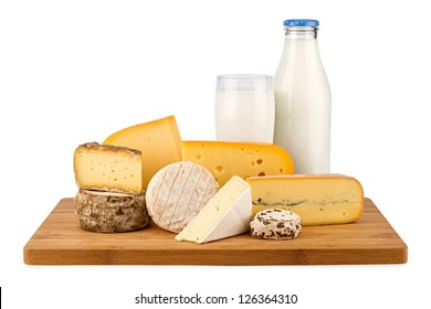 board with cheeses and milk bottle