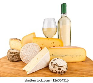 board with cheeses and white wine
