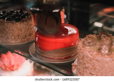Board with delicious cake on table
