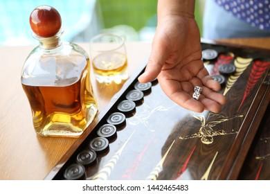 Board game in backgammon. Man playing backgammon