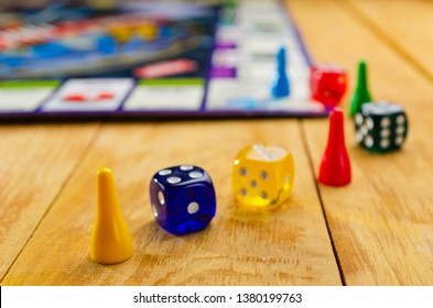 board game with colorful cubes and chips on a wooden background