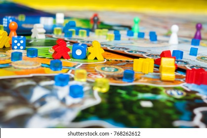 Board game concept- many board game field figures, meeple, dice and coins