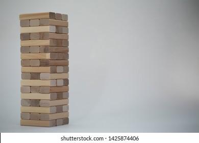 Board game jenga tower of light wood sticks