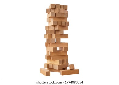 Board game Jenga Tower made of wooden blocks. A tower of unevenly shifted wooden beams. A lesson for agility, logic and coordination. Home entertainment. Balance. Close-up. Isolation, white background