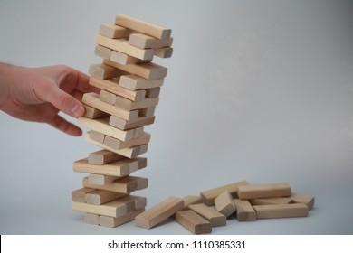 Board game jenga tower of wood sticks