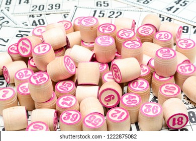 Board game lotto or bingo. Many wooden lotto barrels with numbers lying on lotto cards. game, Russia.