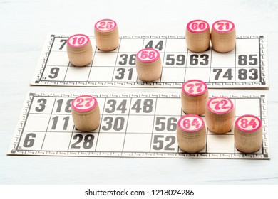 Board game lotto or bingo. Wooden lotto barrels with numbers and card on white table during a game. Vintage game, Russia.