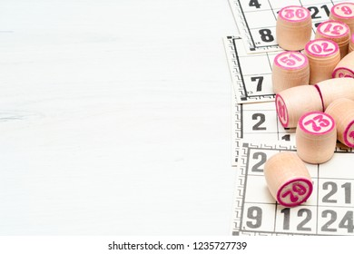 Board game lotto or bingo. Wooden lotto barrels with numbers lying on lotto cards, with copy space. Vintage game, Russia.