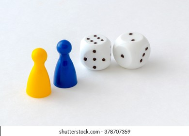 Board game pieces and dice on white background