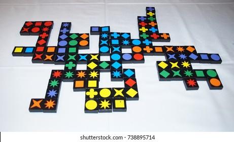 board game Qwirkle. Wooden blocks of Qwirkle