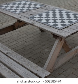 Board games. Intellectual games. The playing field in a cage to play chess or checkers on a wooden table on the street