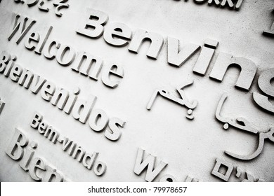 Board with greetings in different languages close up