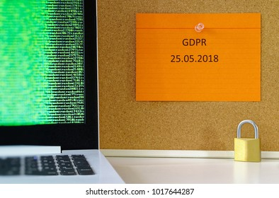 Board with the inscription DSGVO (General Data Protection Regulation) in English GDPR (General Data Protection Regulation) laptop and padlock for the introduction of the DSGVO in the EU 25.05.2018