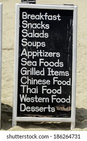 board with a list of dishes in a cafe on the beach of the Indian Ocean Colombo
