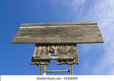 Board on a blue sky background
