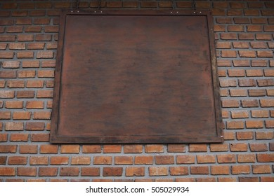 board on brick wall.