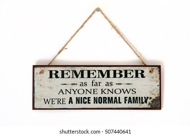 Board on a wall - Remember we are a normal family - Sarcastic funny thought on banner - inspiration hanging sign