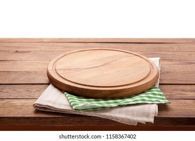 Board for pizza and tablecloth closeup on wooden table isolated. Canvas, dish towels on white background top view mock up. Selective focus.