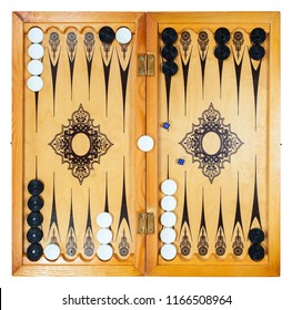 Board for playing backgammon with pieces and dice on a white background. Top-down view