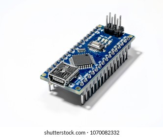 Board for prototyping Arduino Nano  isolated on white background.  The brain for robots. Arduino Board for engineering prototyping in fablab