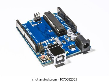 Board for prototyping Arduino Uno  isolated on white background. The brain for robots. Board for engineering prototyping in fablab