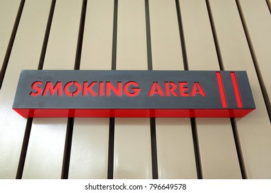Board show zone for smoking area outside building