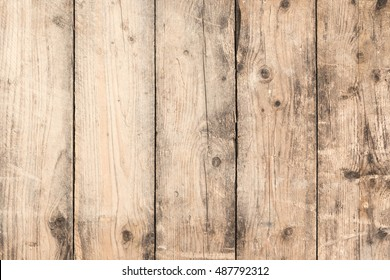 Board wall with old, untreated wooden planks in close up for background; Grunge wooden wall; Wood preservation needed