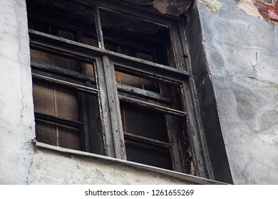 Boarded up burnt windows is close