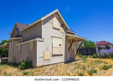 Boarded Up Home Lost In Foreclosure