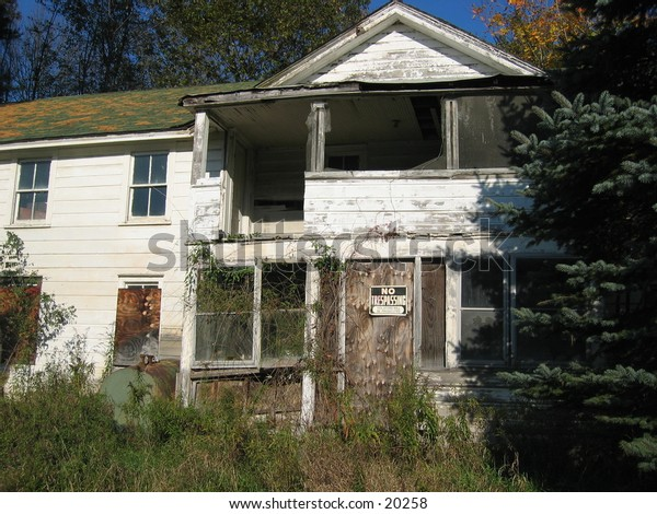 Boarded up house.