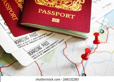 Boarding pass and passport on map with thumbtack concept for travel and vacations