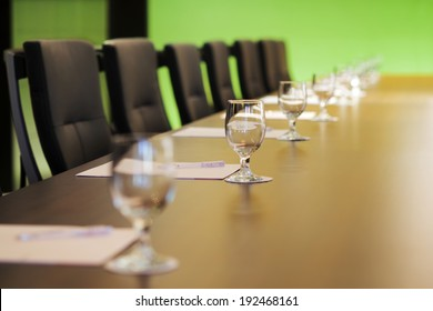 The boardroom table is set for the Annual General Meeting
