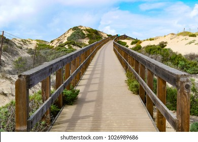 Boardwalk along the sand dunes at Oso Flaco Lake Trail in Oceano Dunes SVRA