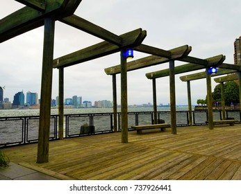 Boardwalk at Battery Park in Manhattan overlooking the Hudson River.
