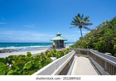 Boardwalk to beautiful Florida beach with crystal clear water and red rocks. Great place for snorkeling. Red Reef Park, Boca Raton, Florida USA