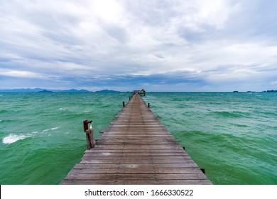 Boardwalk into the blue ocean in Thailand