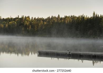 Boardwalk in a lake, Riding Mountain National Park, Manitoba, Canada
