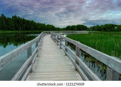 Boardwalk over the lake and marsh at the Sackville Waterfowl Park in Sackville, New Brunswick, Canada.