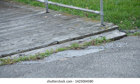 boardwalk planks are a trip hazard and must be repaired