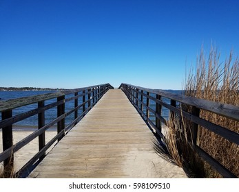 boardwalk and sand and and river