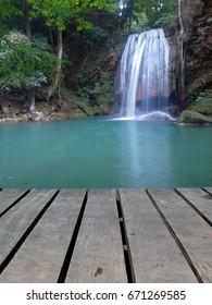 Boardwalk with tier third of Erawan waterfall