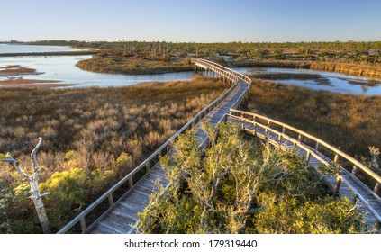 Boardwalk trails cross a tidal outlet to Grand Lagoon in Big Lagoon State Park near Pensacola, Florida