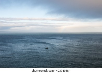 A boat alone in the ocean.