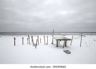 """Boat anchor covered with snow. Russia, Arkhangelsk region, """"Onega Pomorie"""" National Park"""