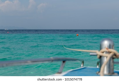 Boat Anchored in Water