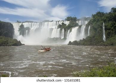 A boat approaching to Iguassu falls (Iguazu/Iguacu), Misiones, Argentina.