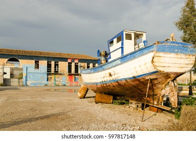 Boat ashore in front of building