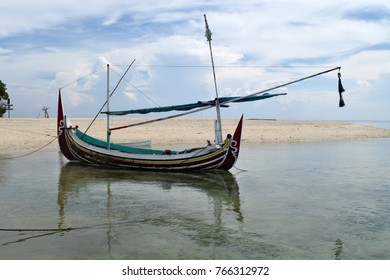 Boat at the beach with a beautiful blue background